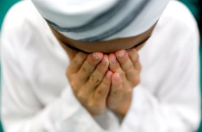 Muslim boy performs prayers on the first Friday of the holy fasting month of Ramadan inside a mosque in Bangkok